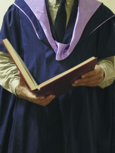 PhD-graduate-robe-book-hands