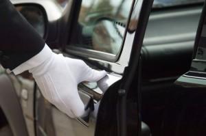 white-uniformed-formal-glove-opening-car-door